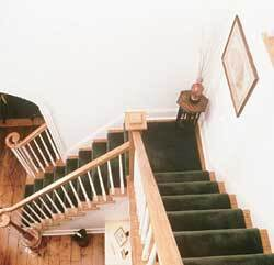 A 12-foot-square tower allowed remodeler Joseph Jackson to open up the staircase in the foyer in this barn conversion.