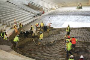 Rossetti crews install the ice rink floor for the Pegula Ice Arena at Penn State University.