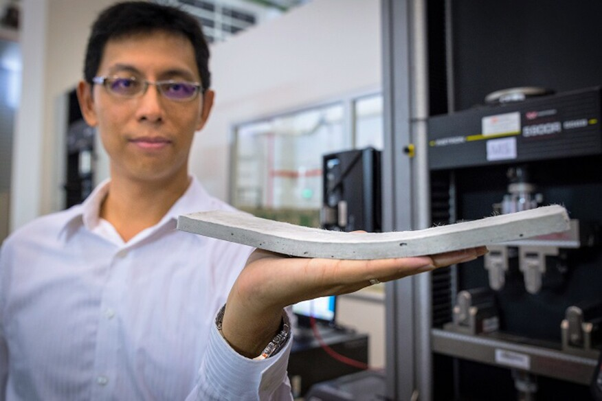NTU assistant professor Yang En-Hua, holding the bendable concrete his team invented.
