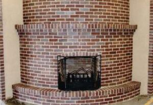A student at the Sierra Conservation Center Adult School in Jamestown, Calif., completed this fullmasonry fireplace. It includes a firebox, smoke shelf, and throat with flue liners and an ash dump.