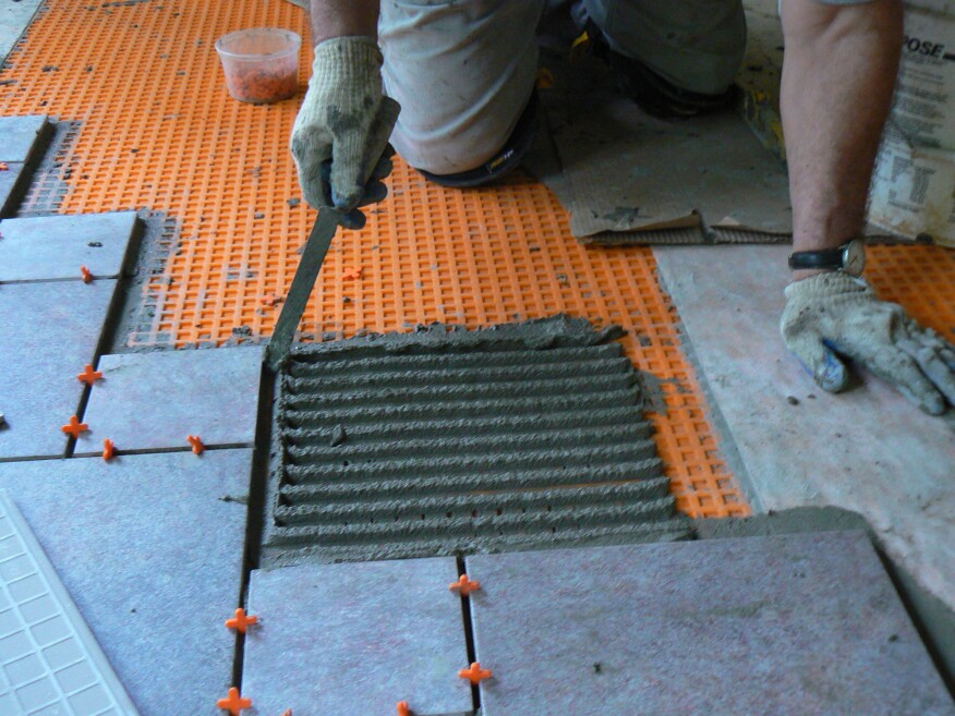 The author set the tile in unmodified thinset applied with a ½-inch-by-½-inch notched trowel.