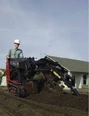 Figure 5. The key to profitability in owning any machine is keeping it busy. Subcontracting for small jobs such as trenching for underground electrical conduit is one way to pay the bills.