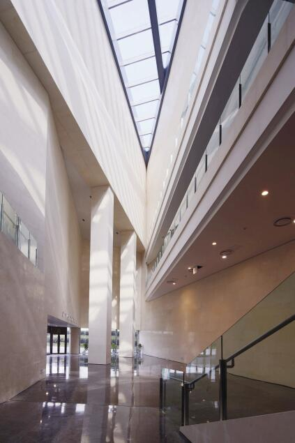The atrium's appearance changes with each sight line (here, looking south toward the main entry) as the parametric form of the building reveals itself.