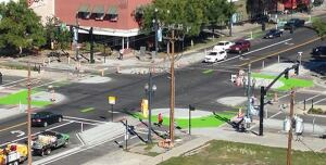 Cyclists and pedestrians use separate crossways in protected intersections such as this one in Davis, Calif. Home of the Bicycling Hall of Fame, the city launched its cycling network in 1966, installed the nation's first cycle signal in the 1990s, and has a bicycle commuting rate of 22%.