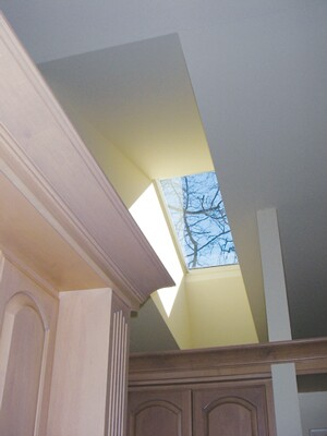 A great source of natural light, skylights can also create heat issues. Installing an exterior shade can help temper the sunlight, but it may not work well in colder climates.
