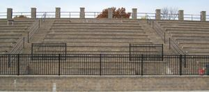 When completed, there was no need for a sound buffer, which neighbors would have sought if noisy aluminum bleachers had been installed.