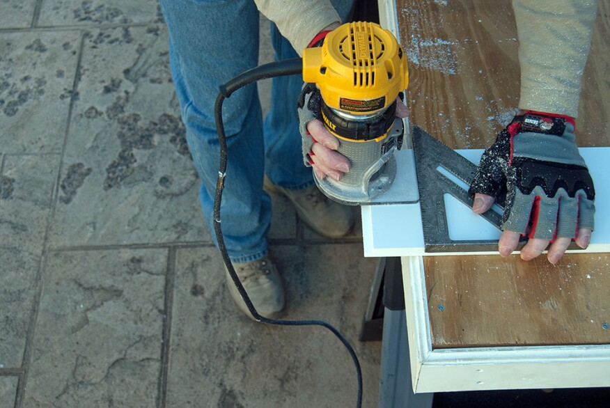 Longer lengths of PVC trim require a movement joint, which the author creates by first cutting a matching shiplap profile on the end of each board with a router.