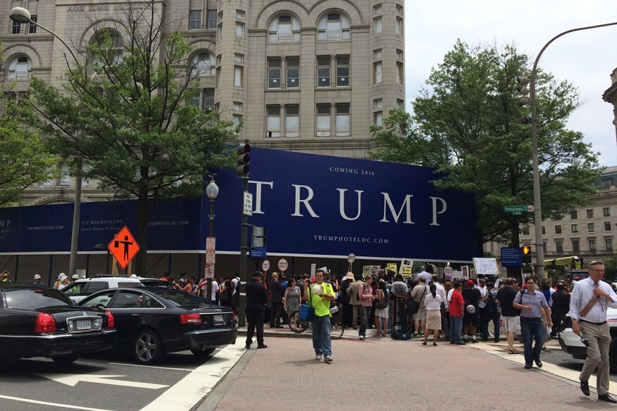 Protesters outside theOld Post Office Pavilion in Washington, D.C., on Thursday. The building is currently being converted into theTrump International Hotel.
