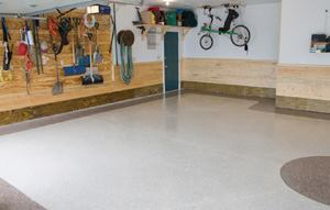 The convenience of returning everything to the garage the same day was the deciding factor for the homeowner in favor of this two-tone hybrid polyurea installation.