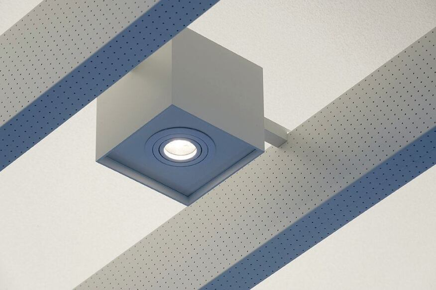 Detail of the perforated, indirect LED baffle and the custom square LED downlight that sits in between.