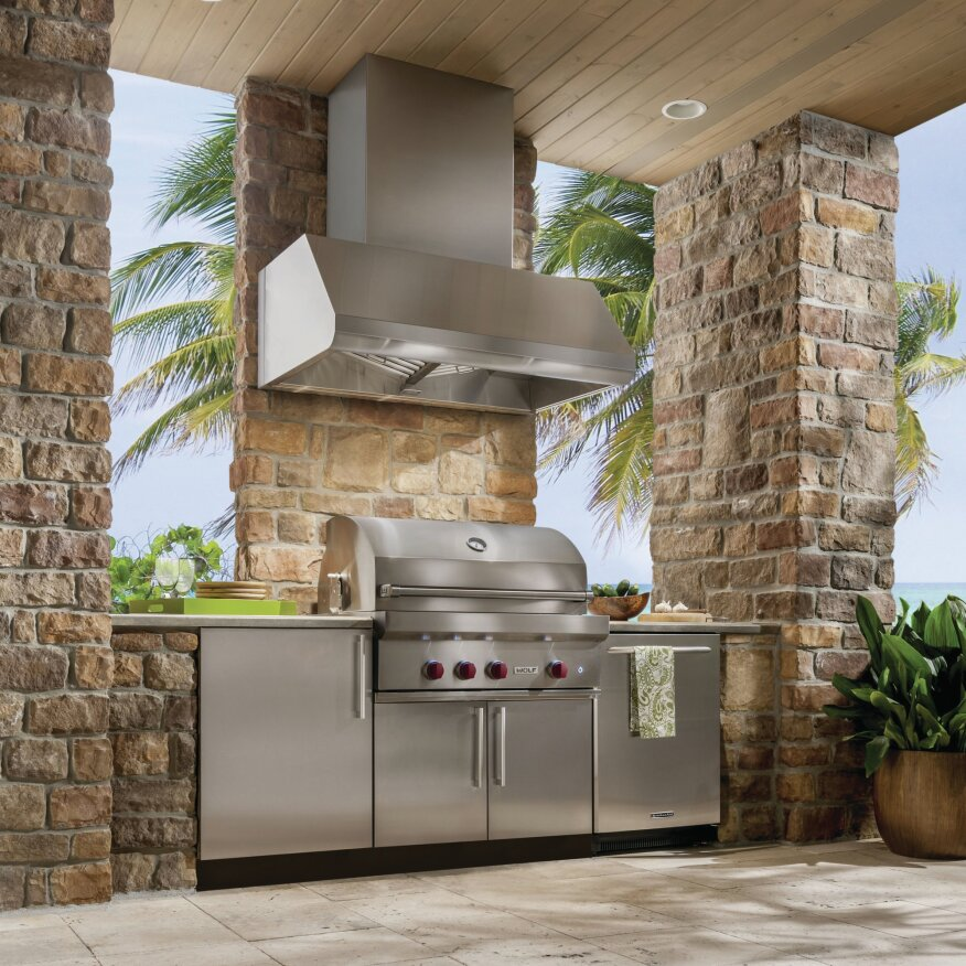 Try these upgrades to your outdoor kitchen remodeling for Outdoor kitchen grill hood