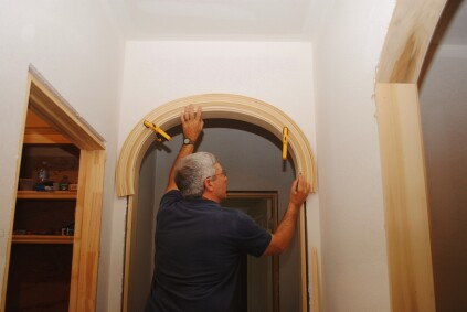 To fit an ellipse first make sure the arched trim is in position for the most even reveal across the arch. With the trim clamped in place, mark where it transitions to the straight sides. These marks should closely correspond to the joints in the jambs.