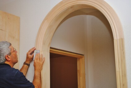 Sand paper smooths out the profile transitions between the arch and the side jambs.