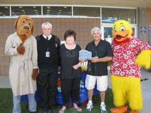 Building awareness: McGruff the Crime Fighting Dog and Tim Szymanski,  Las Vegas Fire and Rescue Public Education & Information Officer,  assist Lois Tarkanian, City Councilwoman, in presenting Joseph Vassallo,  president of Paragon Pools, and Duckie, the Float Like A Duck mascot,  with the 2014 National Drowning Prevention Alliance Community Lifesaver  Award. The presentation was made on behalf of the NDPA during Vassallo's  annual water safety event on May 24 at the YMCA in Las Vegas.