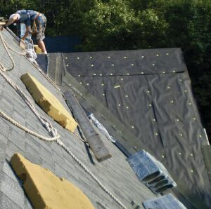 Some roofers install underlayment vertically over short steep roof decks to provide quicker protection from the weather, but not all building inspectors will approve this practice. In general, the IRC specifies horizontal underlayment installation.