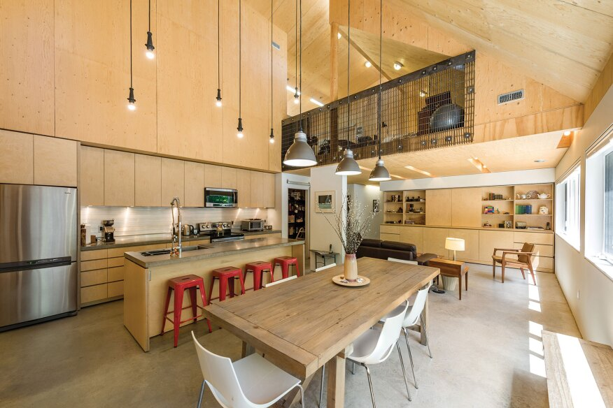 Lofted art spaces look into Moore Studio's double-height kitchen.