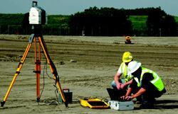 A Walsh Construction survey team defines an area to be scanned on a runway construction project at O'Hare Airport in Chicago.