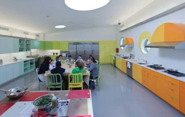 Students enjoy a kale salade they helped to prepare in the kitchen classroom.