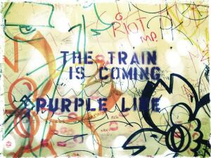 A sign announces the arrival of the Purple Line, a temporary train station designed to show Miamians the benefits of public transportation. Project leaders exceeded their $2,000 fundraising goal using www.kickstarter.com.