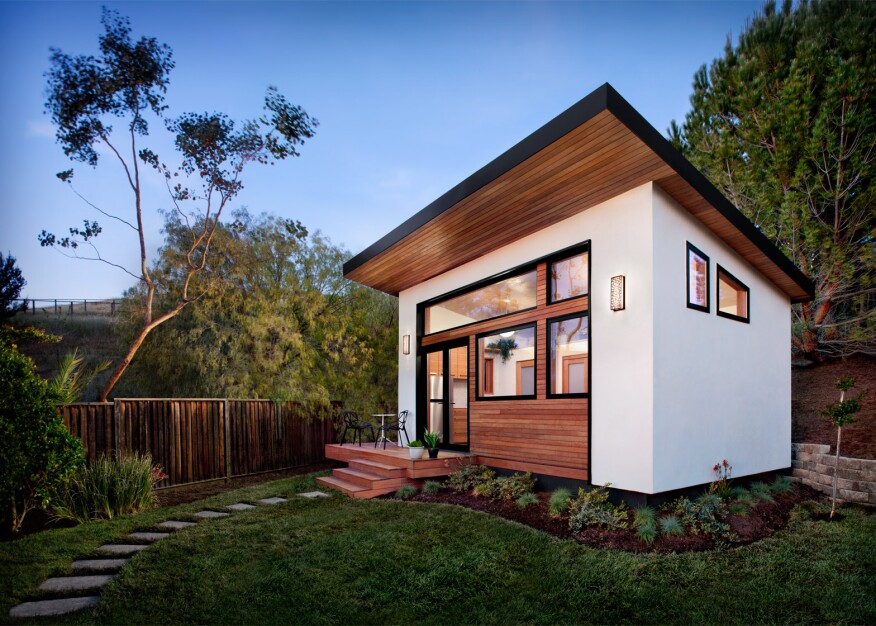 These net zero ready modular homes arrive in flat packed for Eco friendly water systems for homes