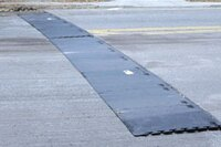 Ramp protection for raised manholes