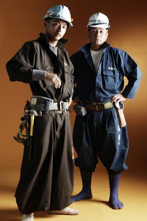 A photo from the catalog of the Kaseyama Co., a Japanese manufacturer of work wear, shows carpenters posing in tobi pants and jika-tabi boots. This style of work clothing is named for and popular with those trades that work high above the ground.