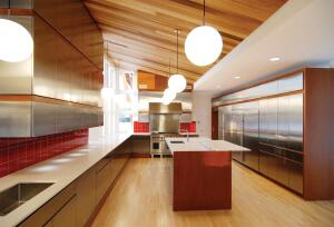 The kitchen's vertical-grain fir ceiling rises to the west wall.