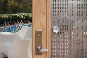 Screen Door A twist of the handle in this door lite moves two aluminum panels to adjust light and privacy.