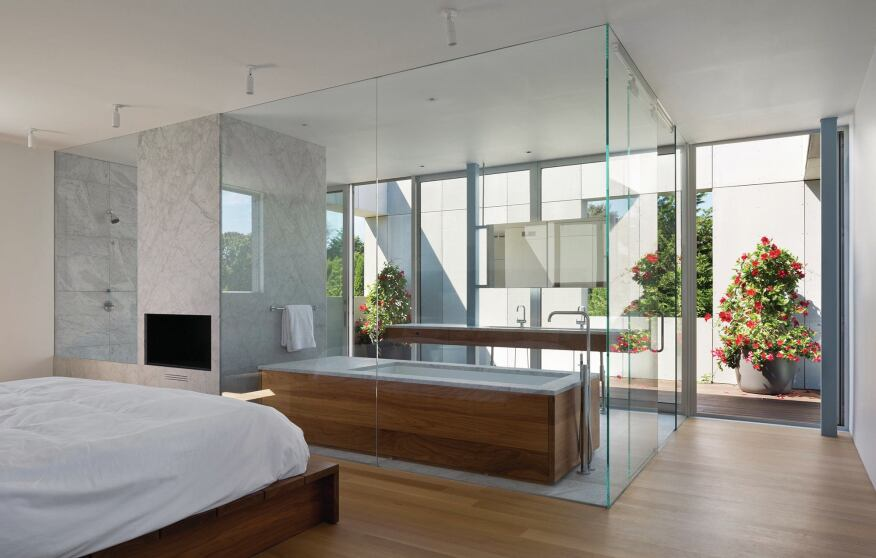 Master suite, with glass-enclosed bathroom and terrace beyond