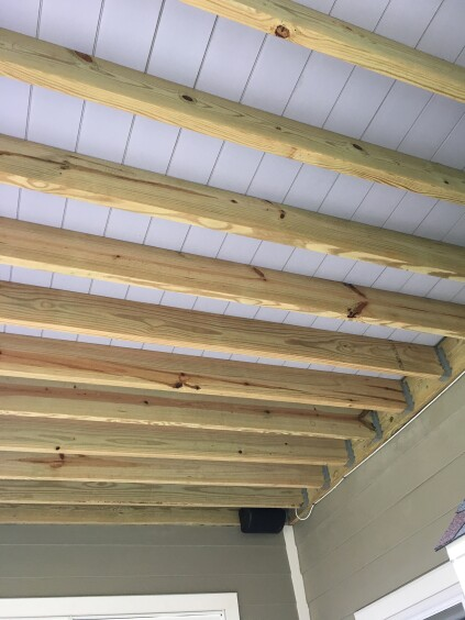 The installed decking also creates a bright ceiling for the space underneath.
