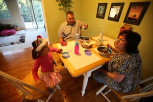 Maria Smith, right, has dinner with her husband Tim and daughter Siena, 3, in their home on Tuesday, March 15, 2016 in Hayward, Calif.  Maria Smith lives in Hayward and teaches at Bollinger Canyon Elementary School in San Ramon.  (Aric Crabb/Bay Area News Group)