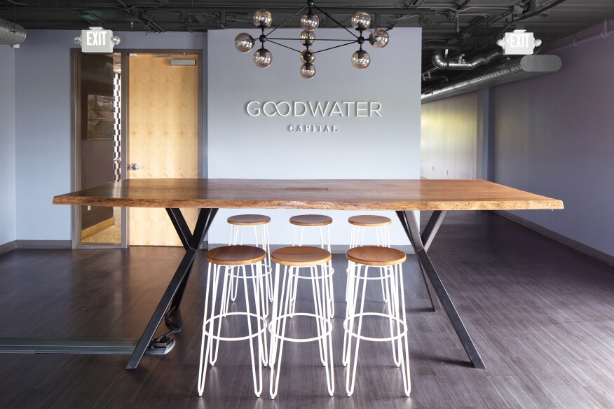 This live edge, elm table with blackened steel legs was custom made for Goodwater Capital.
