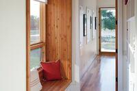 Window Bench Turns Narrow Hallway Into Cozy Nook