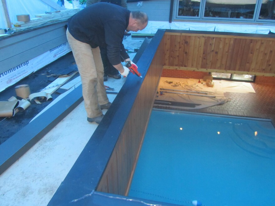 For a pool shelter, roofers were able to wrap the EPDM roof all the way over the skylight curb, which is sloped to the outside. A bead of sealant at the inner edge will help prevent leaks, but if a leak does develop, the water will simply drip into the pool.
