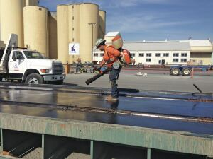 A worker sprays an ultra-thin coating of release agent to make form stripping easier at Clark Pacific's precast plant.