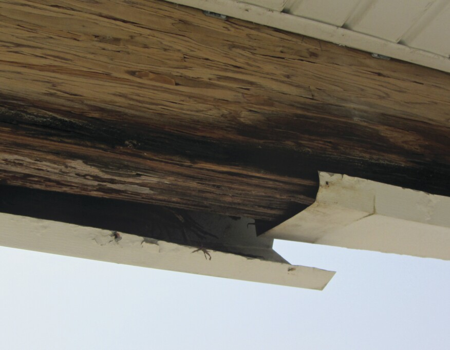 Aluminum capping had been applied over the beams, creating a trough and holding water that leaked in from above.
