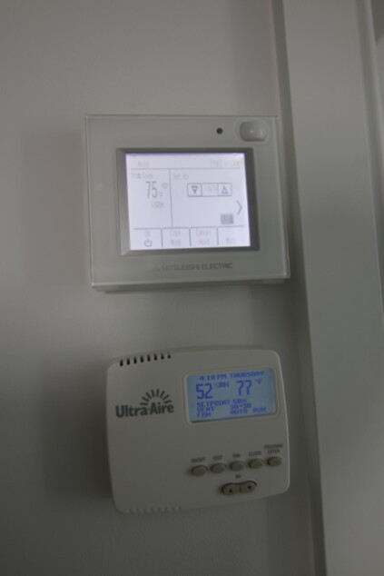 Upstairs hallway has a Mitsubishi controller for temperature, and a separate Ultra-Aire dehumidistat to control the indoor RH