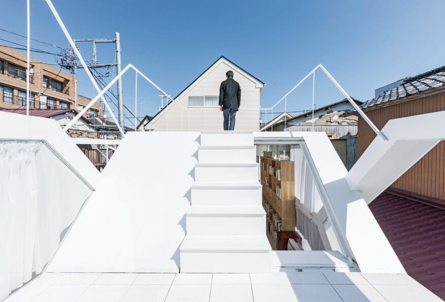 Two ceramic-tiled roof terraces provide outdoor space in the dense urban neighborhood.