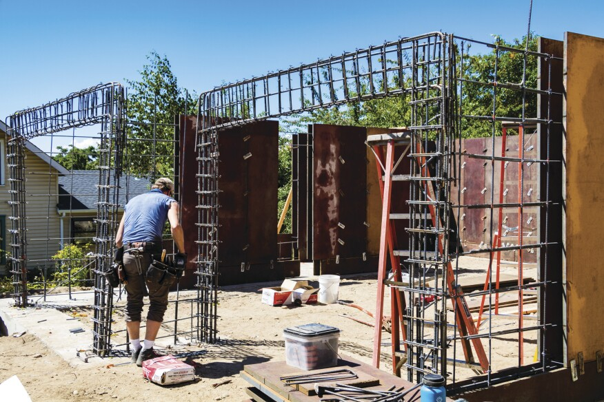 The garage openings required a steel frame formed out of rebar within the concrete walls.