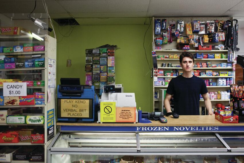 John Cole, a University of Massachusetts student, mans the Harbor Point Market, one of the businesses located in the community's small commercial strip.