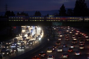 CalTrain speeds across rush hour traffic on Interstate 280 Wednesday evening, Feb. 10, 2016, into downtown San Jose, Calif. (Karl Mondon/Bay Area News Group)