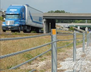 Median guard cable can prevent even big trucks from crossing into oncoming traffic. Photo: Missouri  DOT