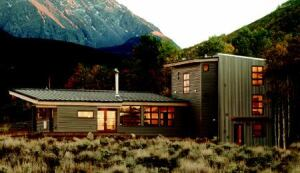 VALLEY HIGH: Nestled at the base of a mountain, the ranch house (above) appears to float in a sea of sagebrush.