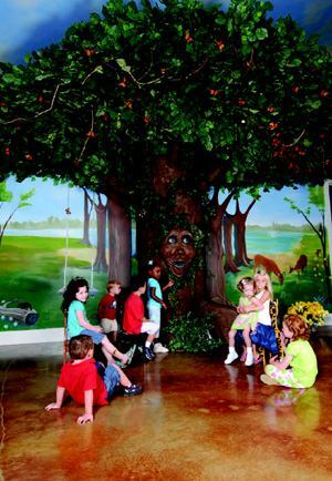 KID FRIENDLY: A talking tree at Sienna Plantation's new Home Finder Center is just one interactive  element that keeps kids interested while parents consider their housing  options.