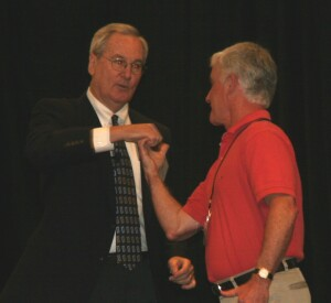 Flanagan uses a volunteer from the audience who did not know how to thumb wrestle to demonstrate the four stages of growth. The volunteer started at the unconsciously incompetent stage. After Flanagan demonstrated the game, he quickly moved to consciously incompetent.
