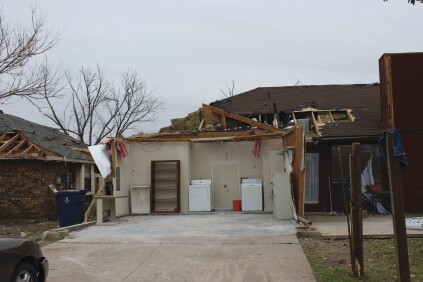 ... and caused the loss of roof sheathing in nearby areas of the main house roof.