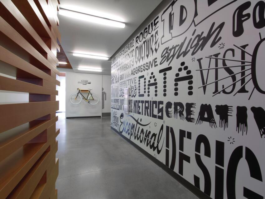 Circulation spaces echo Adobe's commitment to innovation through graphics and product displays.