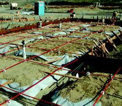 Typical post-tensioned ribbed foundation for residential construction with tendons placed in the center of the slab at approximately 48 inches on center in each direction.