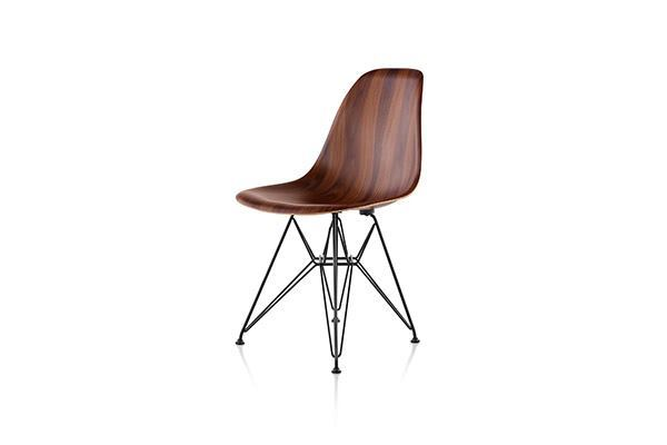 When Charles and Ray Eames introduced the Eames molded plastic side chair in the mid-20th century, plastic was the only viable choice for mass production due to the complexity of the chair's curves. Three-dimensional technology that gives wood veneer more flexibility has allowed Herman Miller to re-release the chair in molded wood. The chair comes in santos palisander, white ash, and walnut. Dowel- and four-leg base options are available. hermanmiller.com