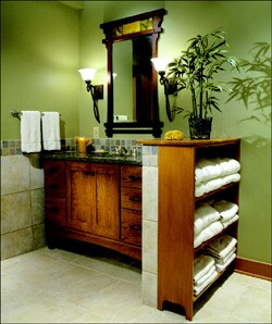 Fixtures flanking the mirror provide better vanity task lighting than overhead strip lights. Designer Peggy Fisher says cross-lighting with 100-watt fixtures creates an even glow.
